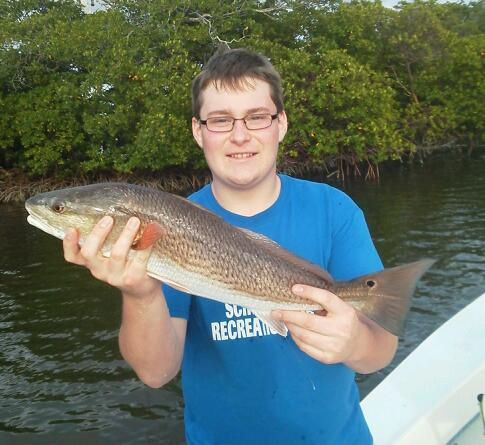Young angler Rich with one of several beautiful redfish he released on an afternoon half day trip. 1/21/2013