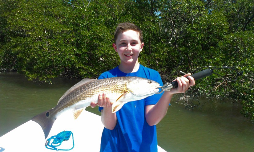 Lee James with a gorgeous back country redfish with Capt. Ben Geroy