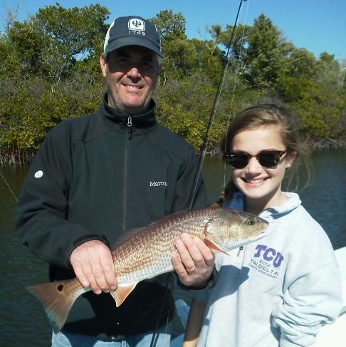 Barrett Gilbert and daughter Mary Harbin with another red on a cool afternoon last week