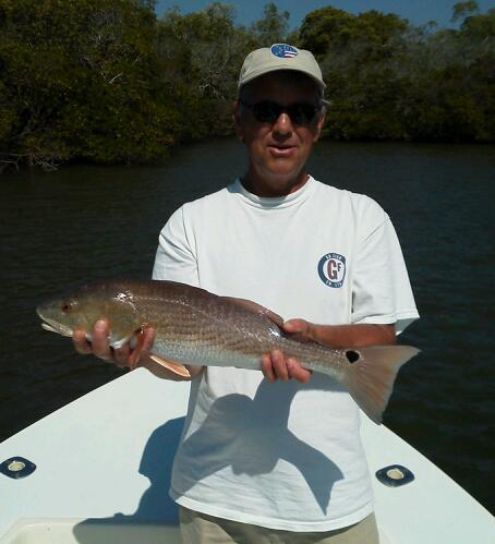 Bill Porter with one of many redfish caught on a recent trip. 04/04/13
