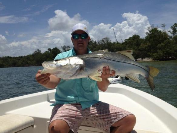 Matt Geroy with a bruiser snook caught and released with his brother Capt. Ben Geroy