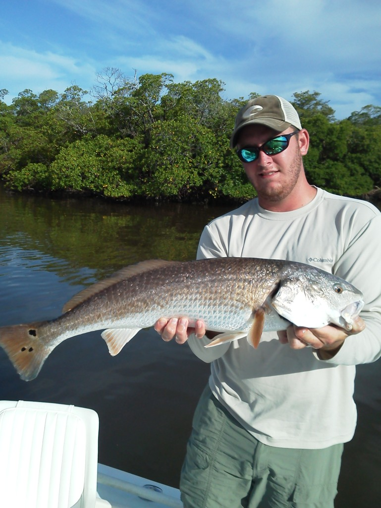 Ben Geroy with a hefty 30 inch redfish before release