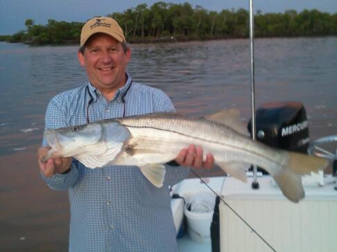 Ron Petnuch with another large snook caught and released last week with Capt. Todd Geroy