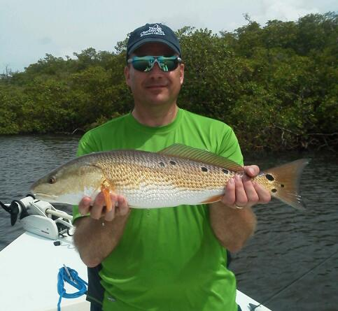 John Schnurbush with a nice multi-spotted redfish before release with Capt. Todd Geroy July 2013