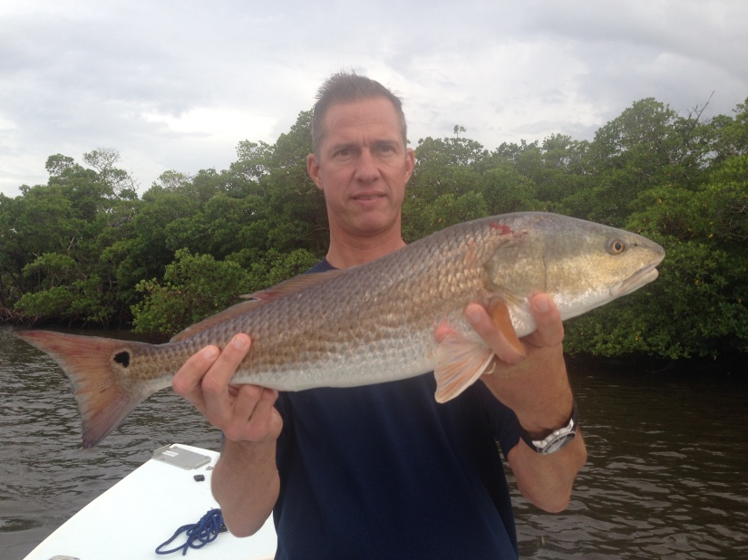 Alan Valadie with a nice red released with Capt. Ben Geroy.