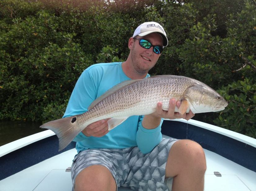 Capt. Ben Geroy with a hefty September redfish