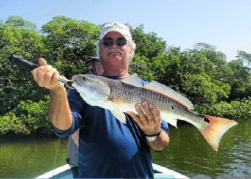 Another redfish comes to the boat at the Naples Take a Soldier Fishing Tournament with Capt. Ben Geroy