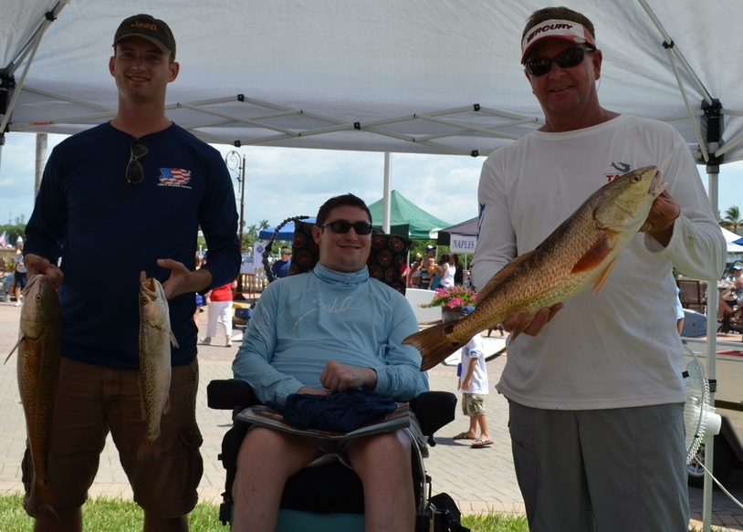 Capt. Todd Geroy and Navy soldier Eric Miller at the Naples Take a Soldier Fishing weigh in.