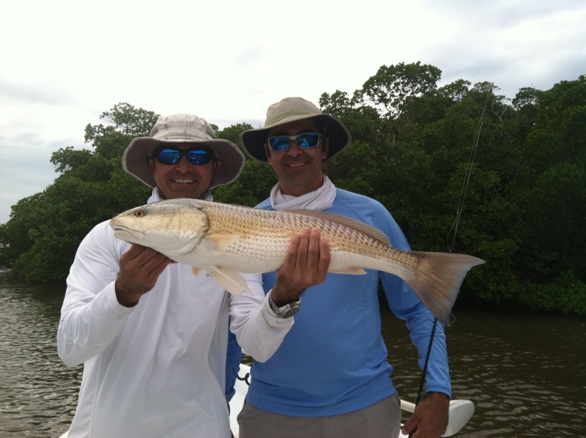 Estaban and Iggy Magana with a large redfish released with Capt. Ben on 11/5/2012