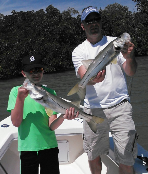 Young angler Nick Seitz and dad, Mike with a nice double on snook during a recent April trip.
