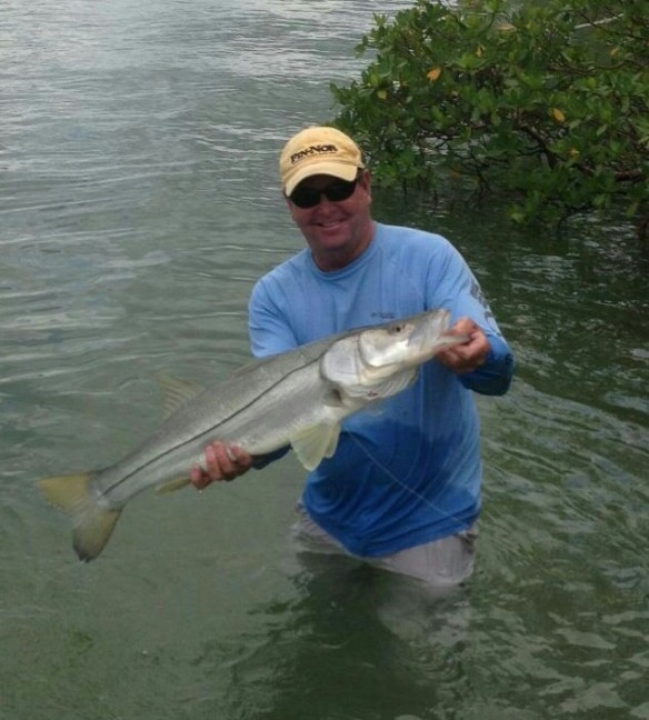 Capt. Todd returns to the boat after retrieving a 15 lb. snook from deep in the mangrove cover.