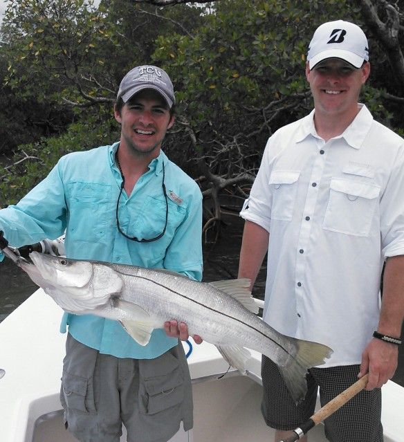 Neil Henges proudly shows off his 15 lb. snook before release on 6/10/14