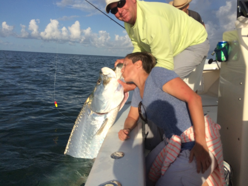 Kristy Pennino give a kiss to her giant tarpon released on 8/12/2014