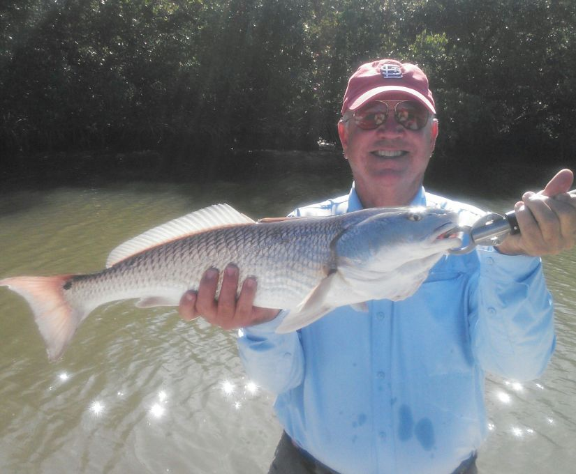 Angler Bob Messey with a nice 26 1/2 inch New Years redfish!