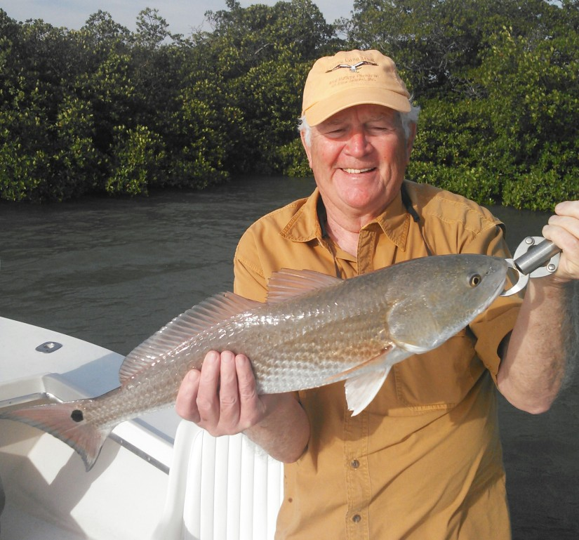 Cornie Morgan with a beautiful upper slot redfish caught on a blustery afternoon trip on 1/23/15.