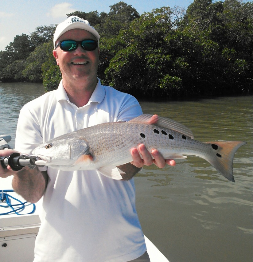 Rick with a beautiful redfish released last week. This one had a total of 15 spots!