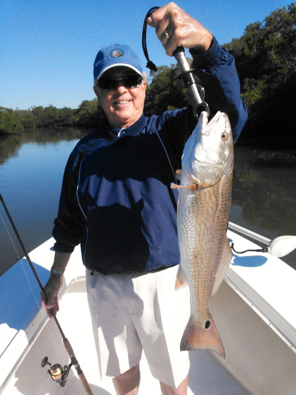 An overslot redfish poses with a happy angler before release last week.