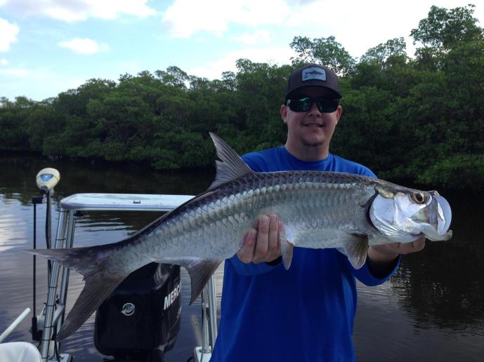My son Matt with a nice baby tarpon released on 9/3/15.