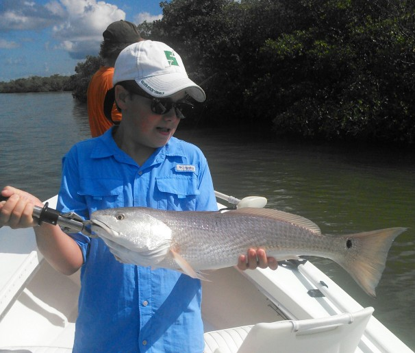 Charlie Crumbp with a nice redfish released on a recent outing with Capt. Todd Geroy.