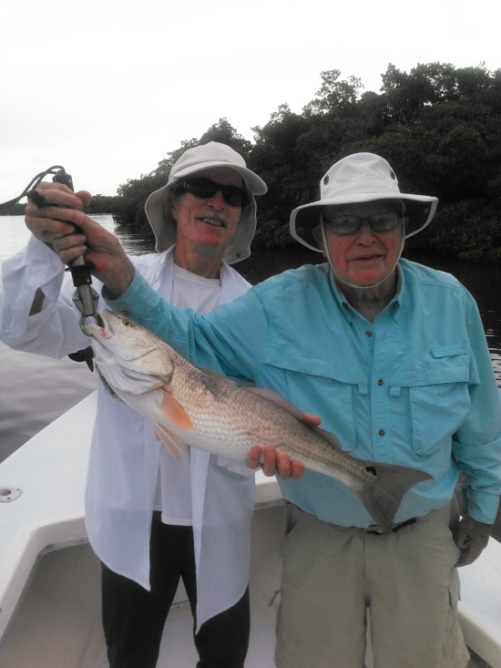 Walt Lewis and his father, Don with one of many redfish they boated last Sunday.