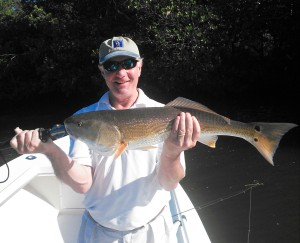 Whit Harvey with an over slot redfish released on 10/20/15.