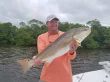 "Capt. Todd with a 35"" redfish released during a recent tournament"
